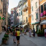 A street populated with tourists in the city of Vernazza, Cinque Terre, La Spezia, Italy